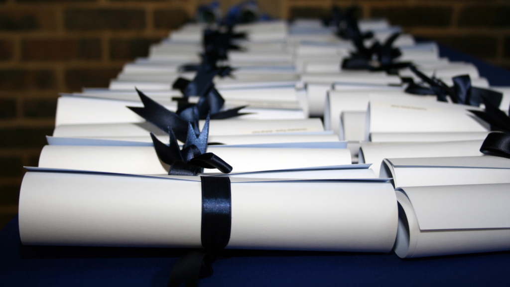 A set of rolled certificates sitting on a table